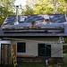 Tyler Installing Slate Roof on Straw Bale Cottage