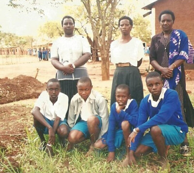 Peter Mumo with school classmates and teachers
