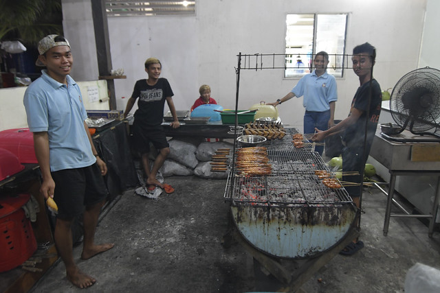 Here's our BBQ chefs. Our fish dinner is still not ready yet.