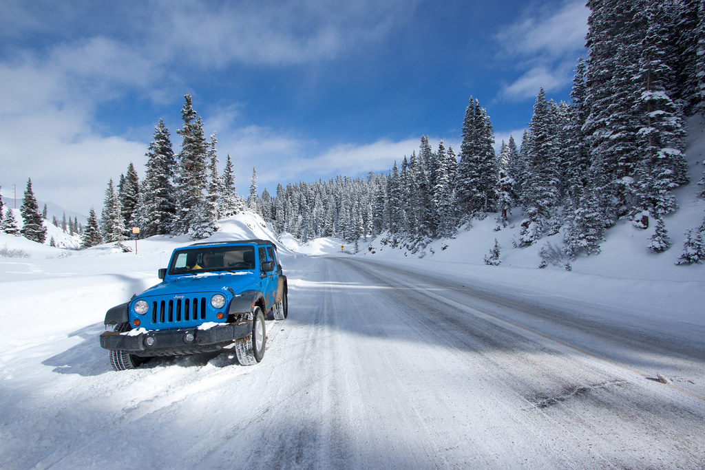 "Jeep on the Snow-Covered ""Million Dollar Highway"" 