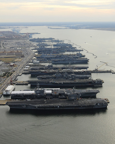 Six amphibious ships and five carriers moored in Norfolk. | by Official U.S. Navy Imagery