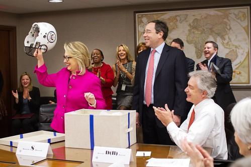 Secretary Clinton Is Presented With a Football Helmet