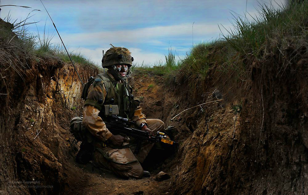 Soldier on Exercise at BATUS, Canada | A soldier waits in ...