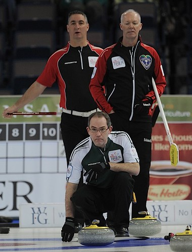 Edmonton Ab.Mar8,2013.Tim Hortons Brier.P.E.I. skip Sean Ledgerwood.Ontario skip Glenn Howard,third Wayne Middaugh.CCA/michael burns photo | by seasonofchampions