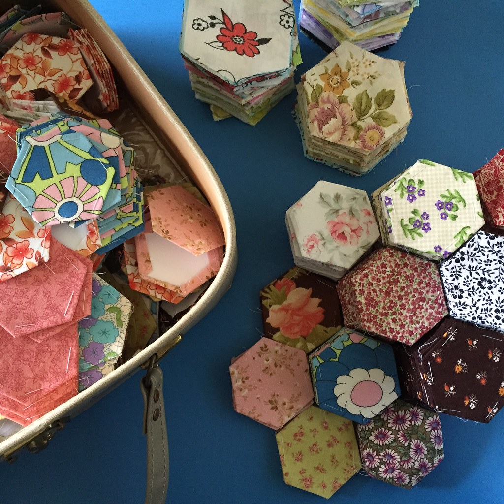 stacking and counting hexies on the kitchen table