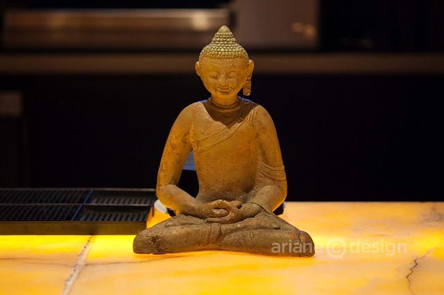 AURA Restaurant buddha at bar