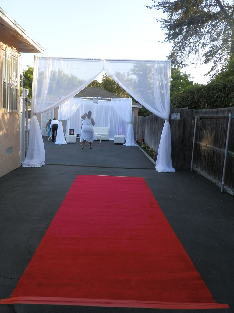 2 post canopy with red carpet by sbd events planning