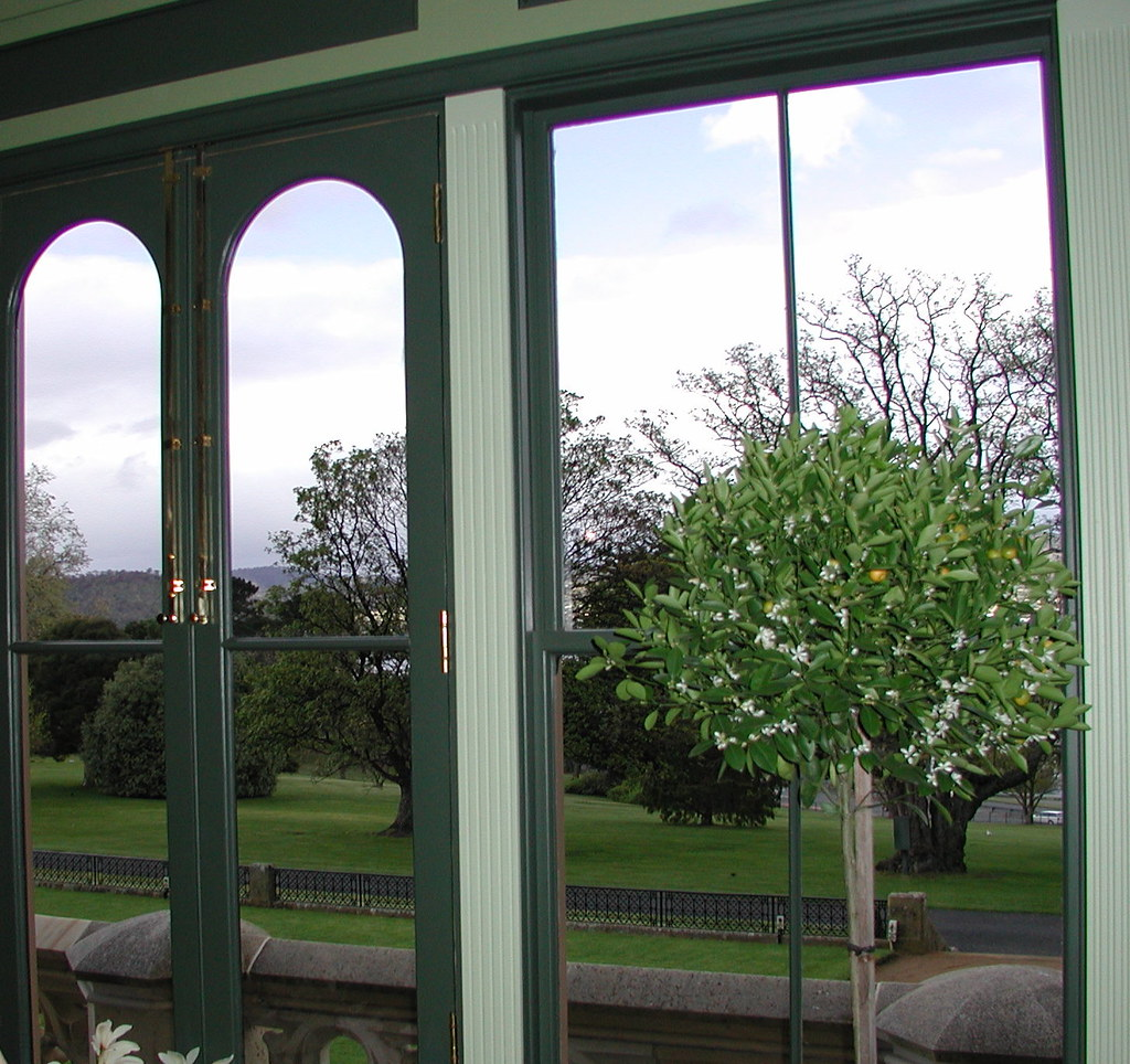 Looking out of a government house window to the gardens for Www house com