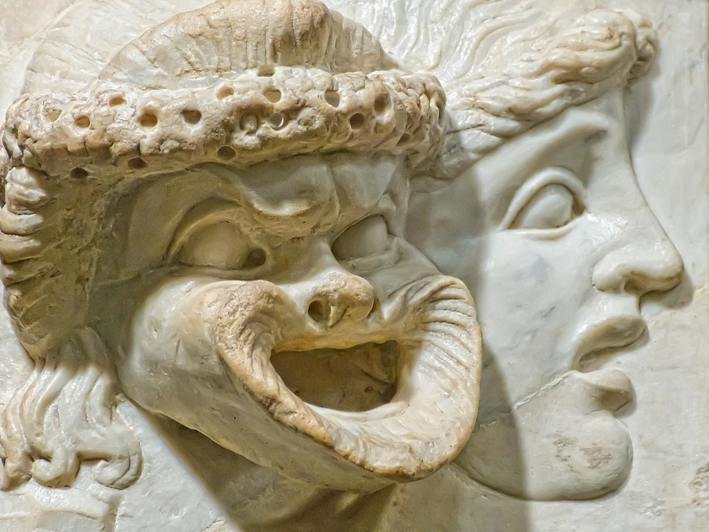Carved marble relief depicting tragic and comic masks roma
