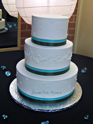 White Buttercream Wedding Cake With Teal And Black Ribbon