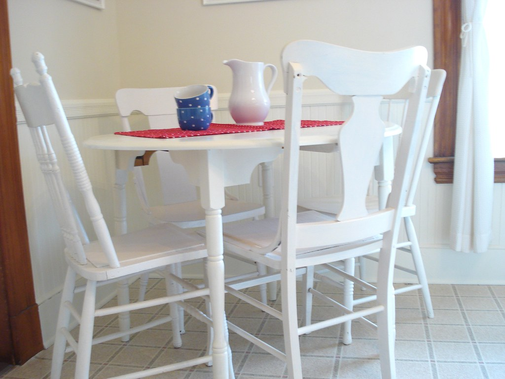 little white round cottage style kitchen table and mis mat flickr