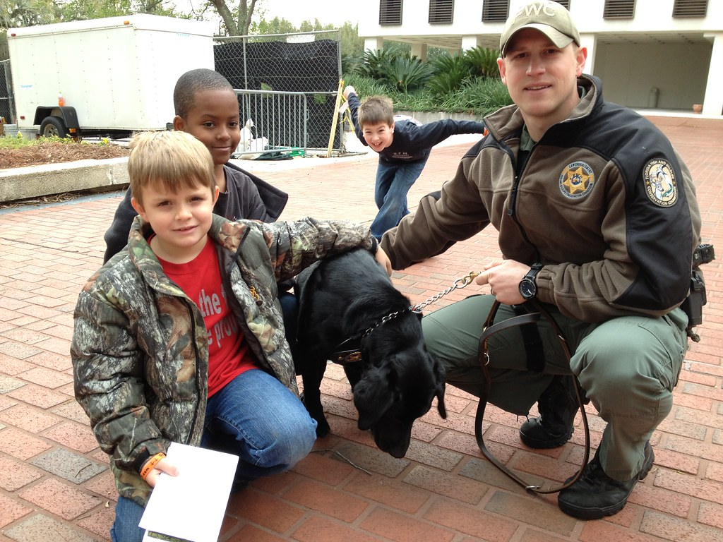 K 9 drake with new friends one guy really wanted to be for Florida fish and wildlife officer