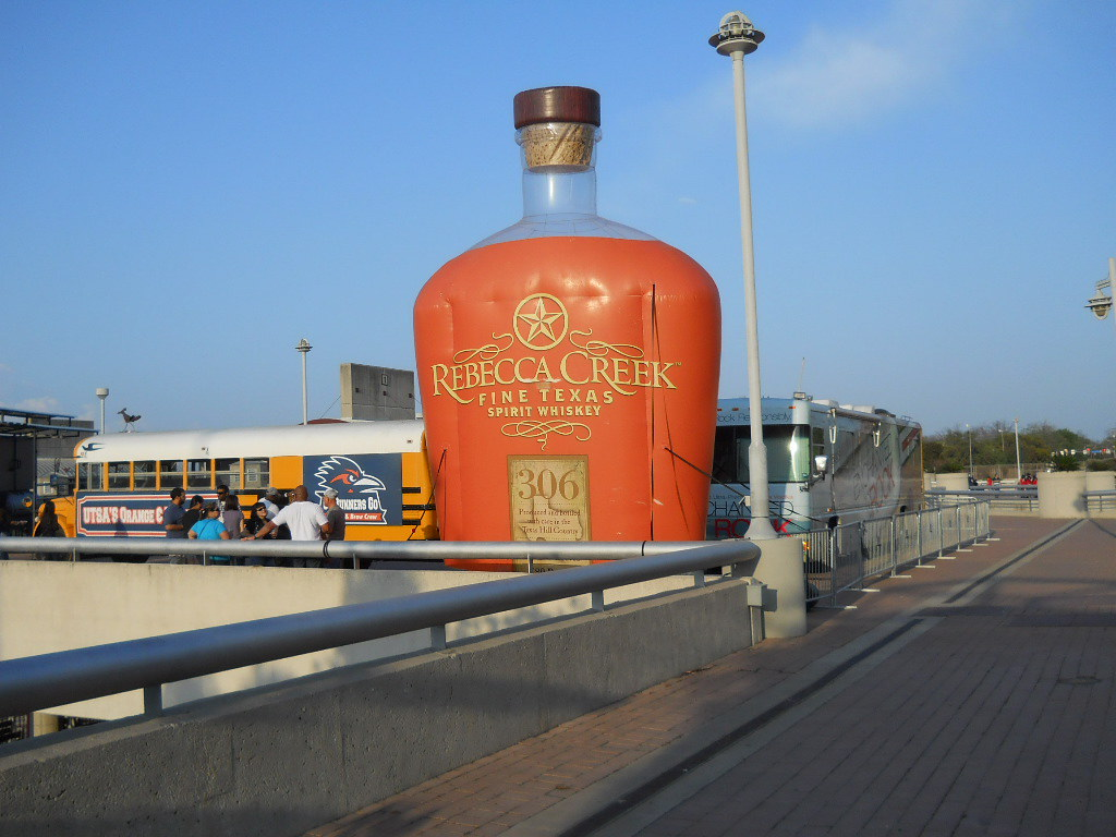 Big whiskey bottle seen in front of the alamodome for Big whiskey s