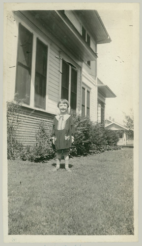 Child at the side of the house
