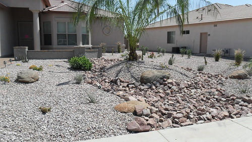 Redesigned front yard landscape with 1 48 pineapple pal for Landscaping rocks lodi ca