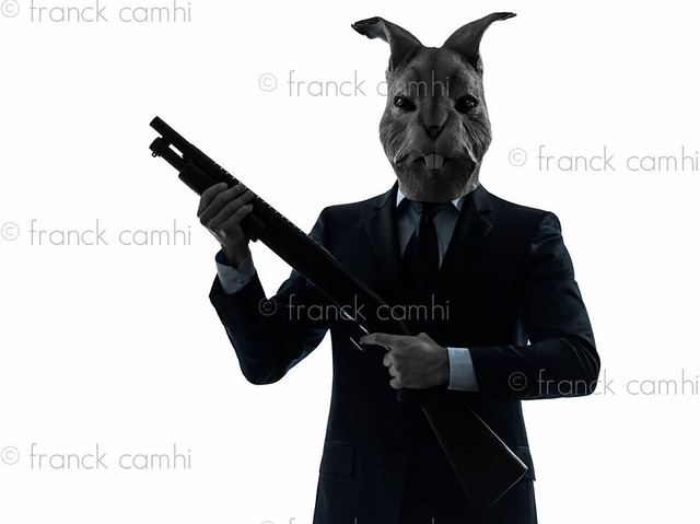 man with rabbit mask hunting with shotgun silhouette portrait flickr