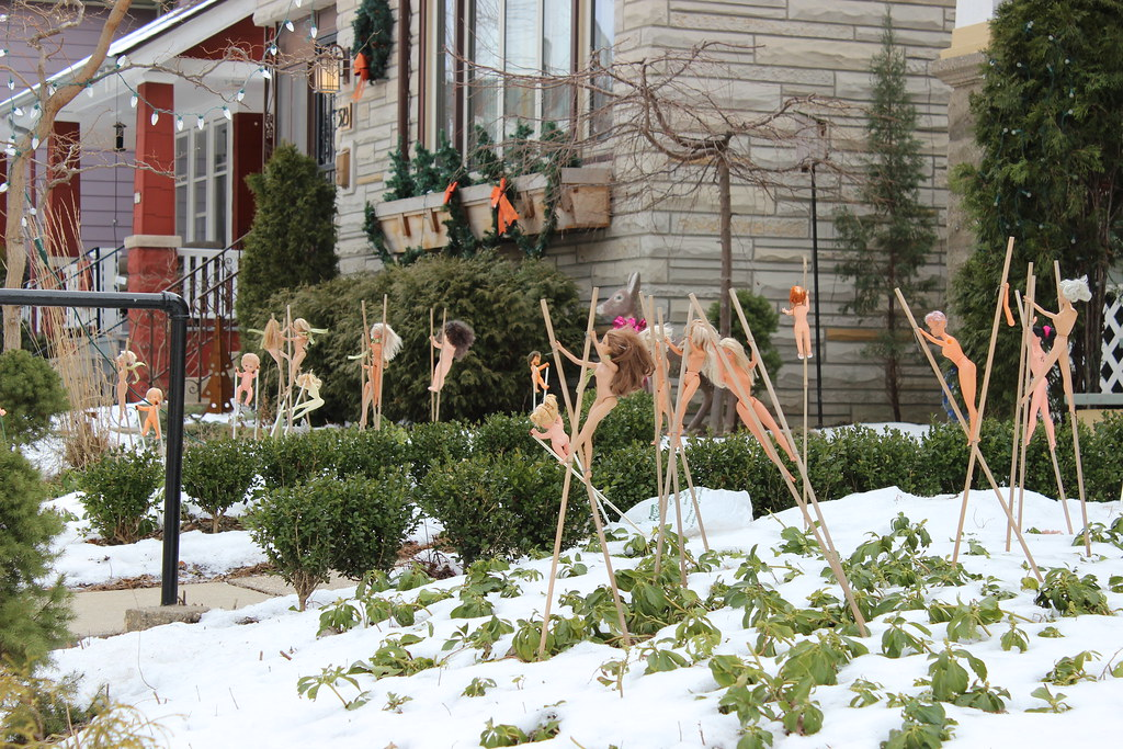 Naked Barbies on Stilts | Found this decorating a front