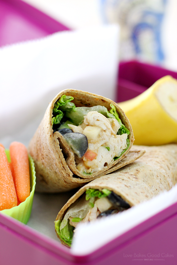 PB Apple Chicken Salad Wraps in a lunchbox with carrots and a banana.