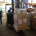 Kit Yamoyo cartons inside the MSL warehouse in Lusaka