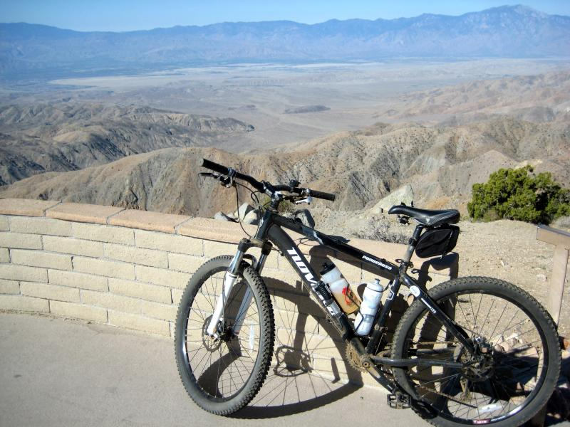 my mountain bike leaned up against the railing of the scenic overlook at keys view