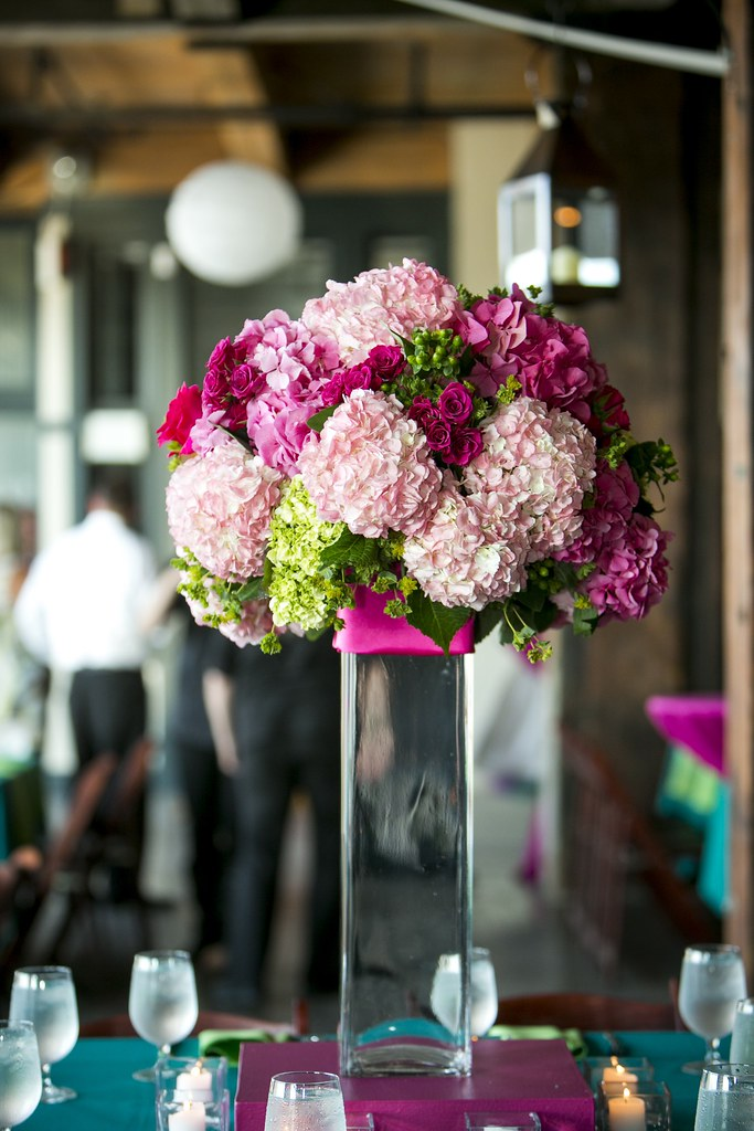 Tall pink hydrangea centerpiece featuring