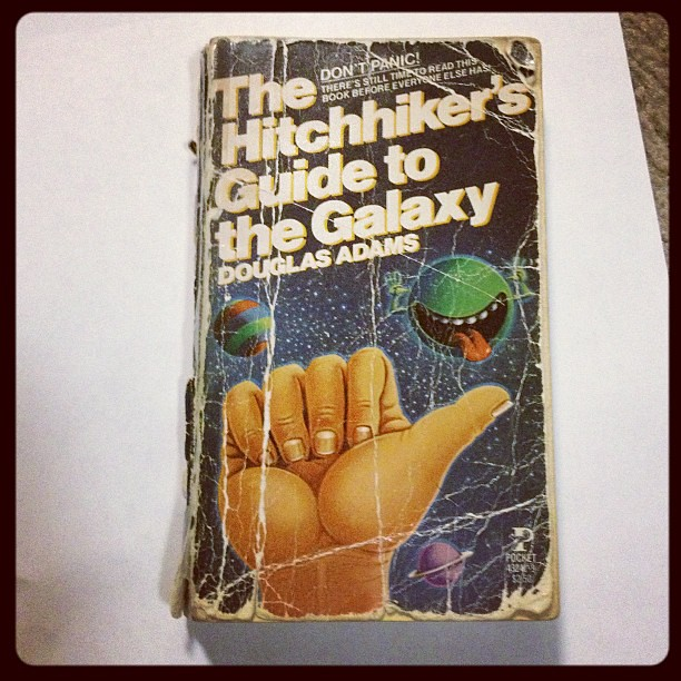 My (much loved) first copy of Hitchhiker's Guide to the Galaxy.
