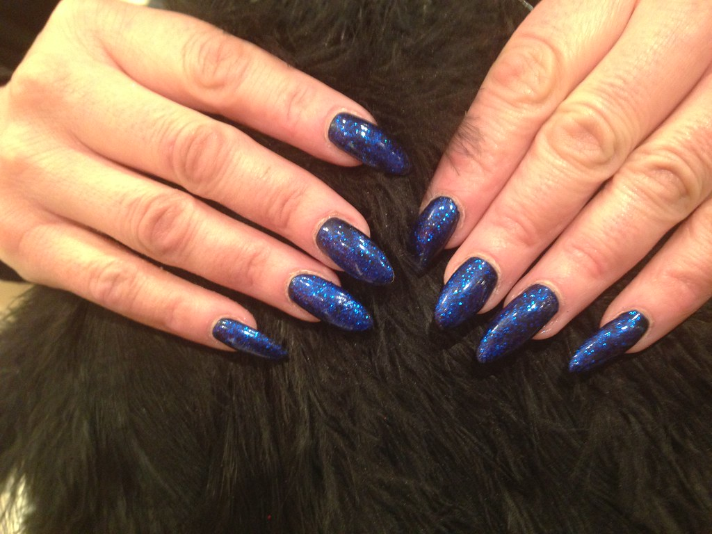 Acrylic nails with navy blue polish with blue glitter | Flickr