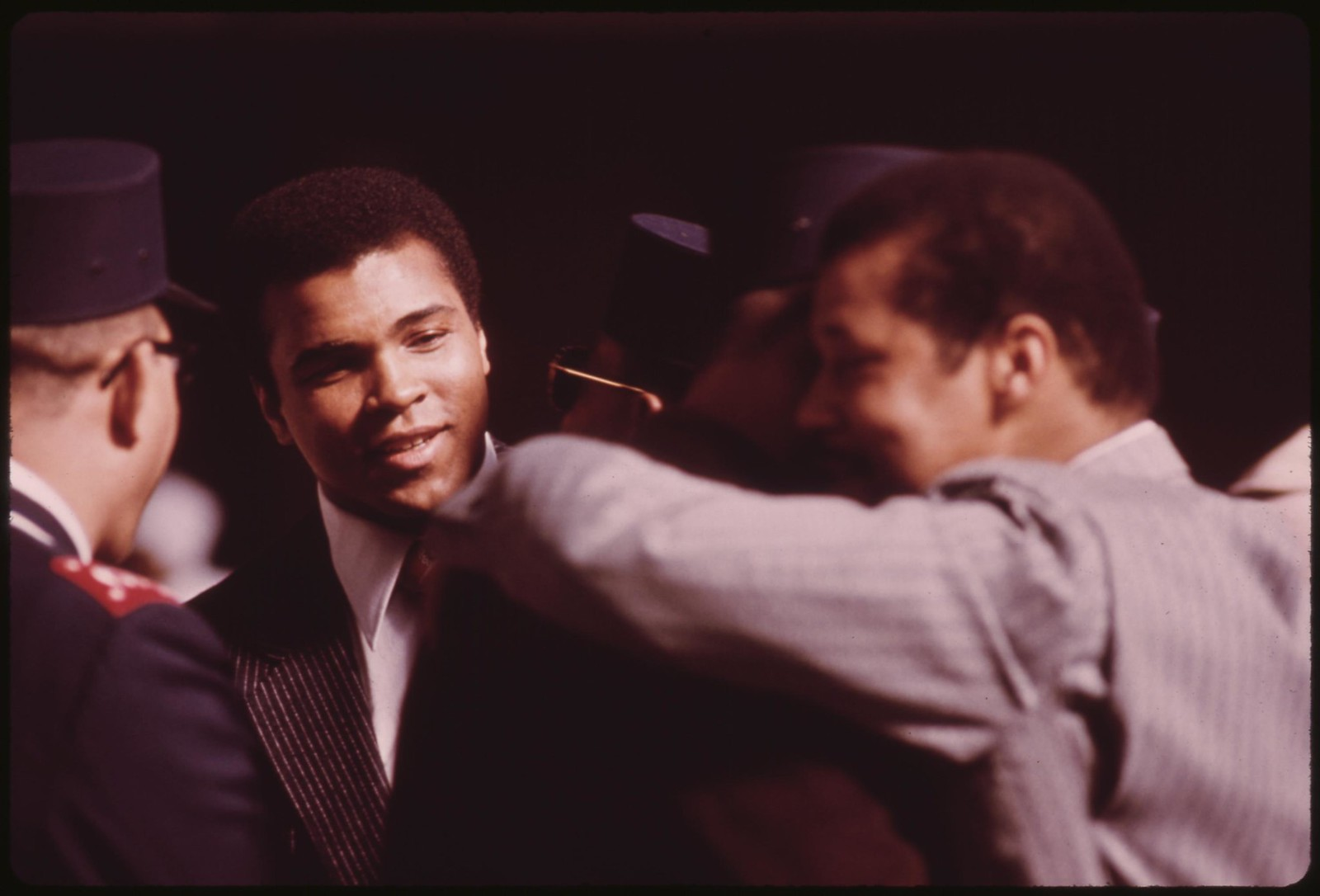 World Heavyweight Boxing Champion Muhammad Ali, A Black Muslim, Attends The Sect's Service To Hear Elijah Muhammad Deliver The Annual Savior's Day Message In Chicago, 03/1974 | by The U.S. National Archives