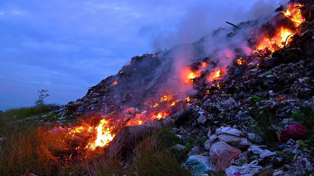 Philippines - burning trash in an open dump site in General Santos