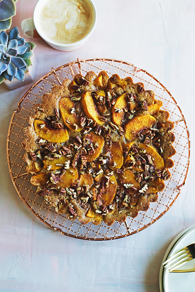 Brown Sugar Peach Buckle - this easy summer cake envelopes sweet peaches with a rich brown sugar and brown butter cake batter that's sprinkled with toasty pecans.