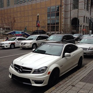 C63 AMG carbon package spotted on the streets of #boston! Beautiful, and expensive.... Love it? I know we do! #euro #mercedes #amg #carbon #c63 #traffic #white #streets #beautiful #carporn | by ConnStanceCT