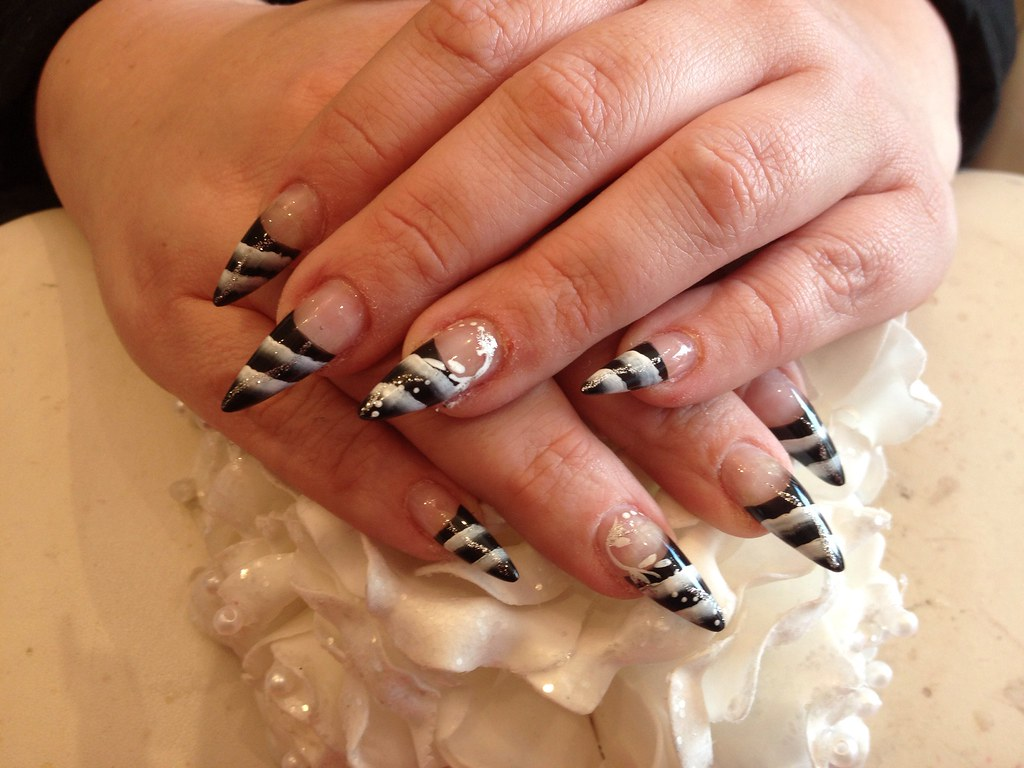 Stiletto nails with black and white one stroke nail art | Flickr