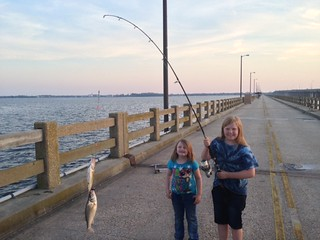 Photo of Two girls with two fish on a fishing line