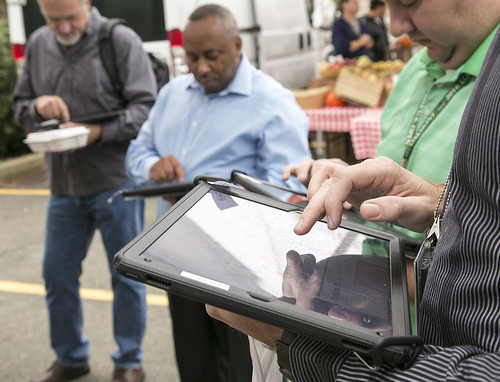 Visitors at USDA's Farmers Market on iPads
