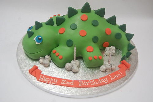 Such an excellent cake for a 2 year old - bold but lovable! The Delicious Dinosaur Cake - from £60.