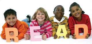 9 year old kids holding letters for READ