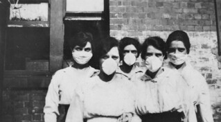 Women wearing surgical masks during the influenza epidemic, 1919 | by State Library of Queensland, Australia