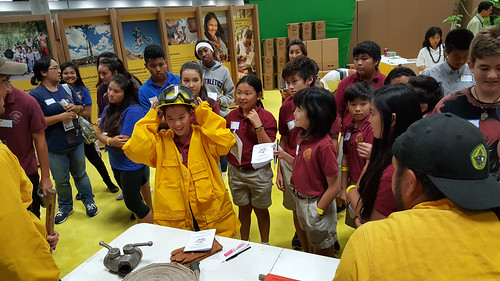 Children trying out firefighting equipment