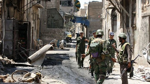 Syrian troops patrol the city of al-Mathan heavily damaged by fighting by loyalists and western-backed rebels. Syria is under threat of regime-change by the imperialist states. | by Pan-African News Wire File Photos