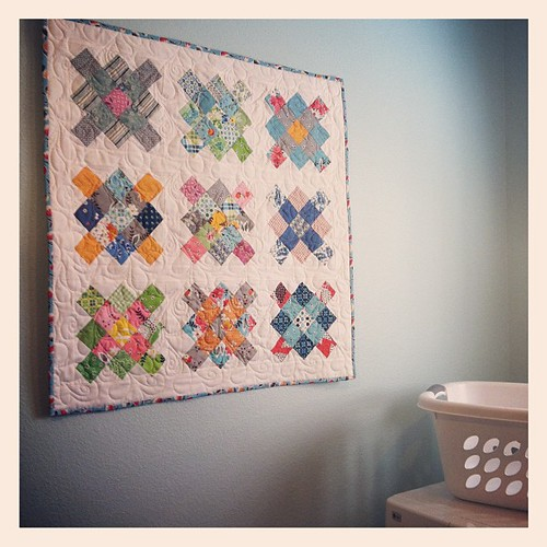 Finally hung my granny squares quilt...makes the laundry room so cheerful! | by QuiltingLife
