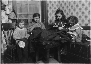 Garment workers. Katrina De Cato, 6 years old, Franco Brezoo, 11 years old, Maria Attreo, 12 years old, Mattie Attreo, 5 years old. 4 P.M. New York City, January 1910 | by The U.S. National Archives