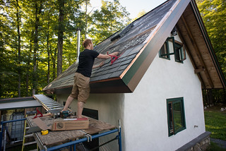 Tyler Installing Slate on Strawbale Cottage Roof | by goingslowly