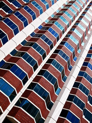 red high rise angle | by Demetrios Lyras