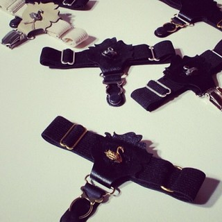 A little landslide of Rose Garters. Gold front and center. #fashion #accessory | by SWANclothing