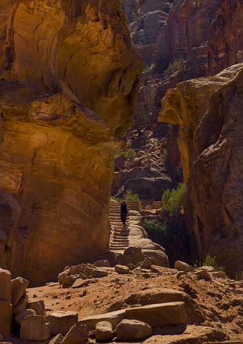 Woman Climbing Ancient Stairs In Petra, Jordan | by Eric Lafforgue