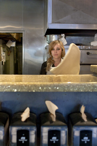 Girl tossing dough in pizza parlor: Photo by Jackie Alpers | by Jackie Alpers