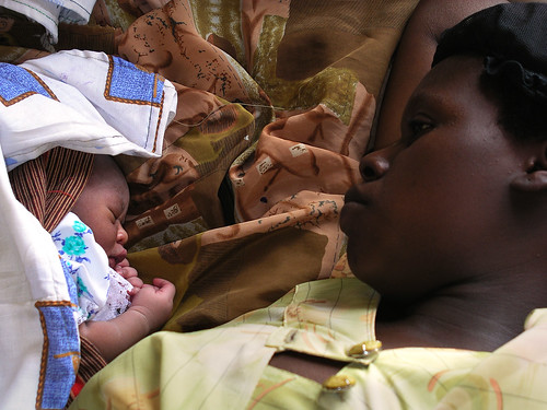 Mother and newborn baby in a clinic | by World Bank Photo Collection