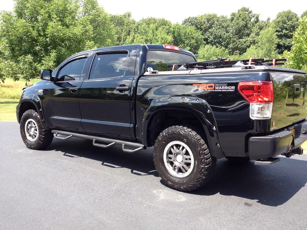 A Black Toyota Tundra With A Black Diamondback Se With Pr