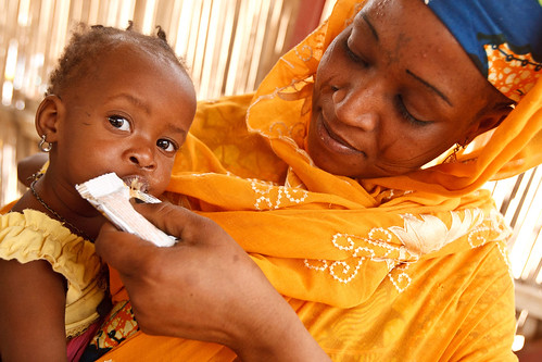 """I challenge anyone not to be moved"". A woman feeds ready-to-use therapeutic food to her malnourished daughter in Niger 
