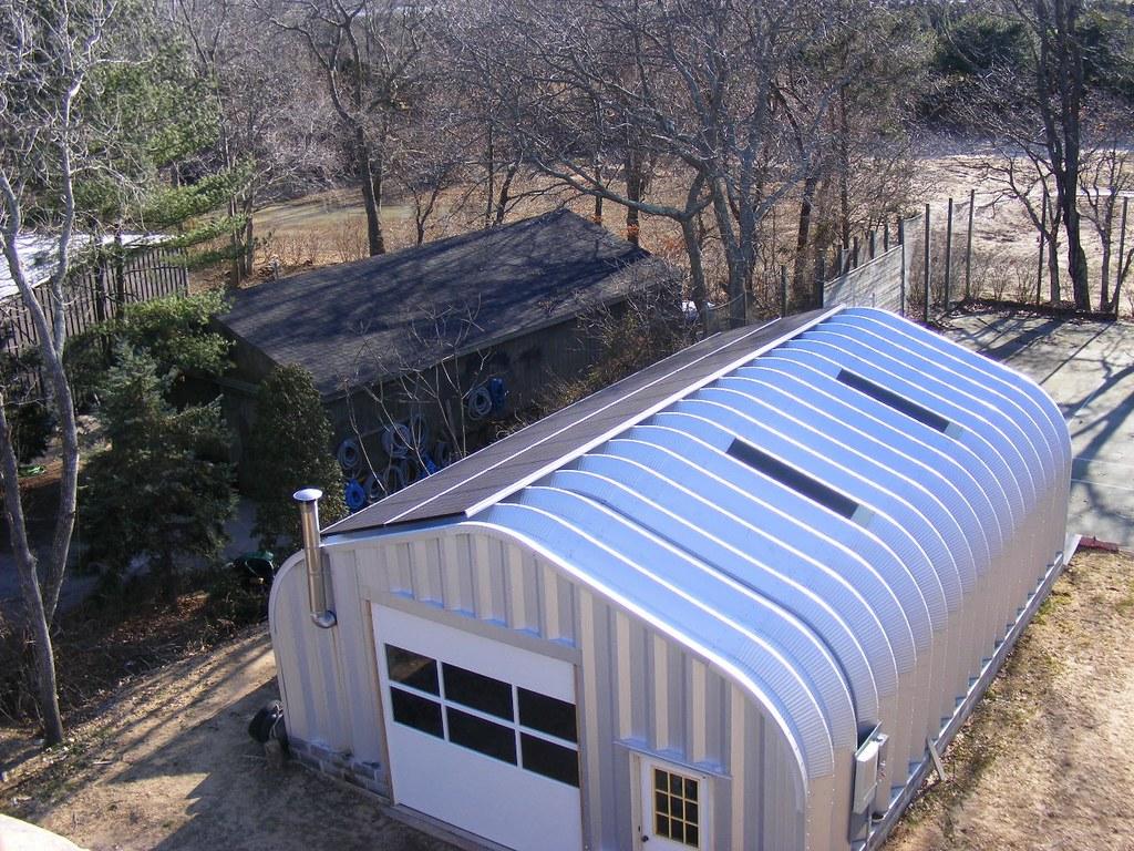 Steel building solar powered metal garage steelmaster for Garage building contractors